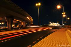 Trail light (Kooltug) Tags: bridge light lightshow doha traillight ashgal kooltug