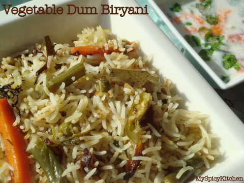 Veg dum biryani in a square serving dish