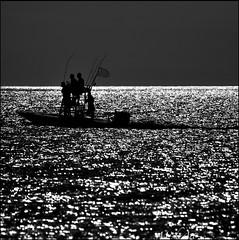 tis not where you've been, it's where you're going.. (M'sheArt2 Photography) Tags: bw men love boat mac nikon florida silhouettes explore nets luminous sparkling  captiva ♪ d300 heartofgold dsc6467 ms❤2 dec2009 msheart~ooo~graphy m'sheart❤2 mesmerizedbytheshimmeringsea ™m'sheart~ooo~graphy sqformatdesaturationtobwandatinyoutlinethatstheextentofworkingit tisnotwhereyouvebeenitswhereyouregoing jan22010381