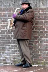 the saxophonist . (Franc Le Blanc .) Tags: lumix candid panasonic streetphoto shertogenbosch streetmusician saxofoonspeler dmcfz18 travelsofhomerodyssey mtrtrophyshot
