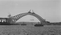 Postcard photonegative of Sydney Harbour Bridge, 1 Oct 1930 / Samuel Wood