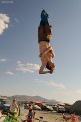 Inverted Flight (naturalturn) Tags: shirtless usa man michael jump jumping nevada trampoline burningman blackrockcity esplanade leap 2009 leaping burningman2009 image:rating=5 image:id=080719
