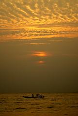 DSC01044 (shashank birudavolu) Tags: morning sea sun india beach water sunrise lens boat early fishing fisherman waves fishermen sony tokina catamaran alpha a100 vizag sonya100