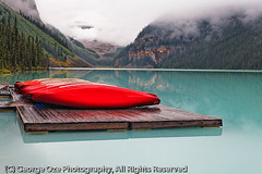 Red Boats on a Dock, Lake Louise, Alberta, Canada (George Oze) Tags: travel summer lake canada horizontal clouds reflections landscape pier still colorful jetty scenic nobody hills alberta northamerica rockymountains serene lakelouise tranquil boatrental banffnationalpark pineforest glacial victoriaglacier glaciallake redboats emeraldgreen forested nonurbanscene