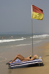 Hoping the tide doesn't come in too far 1 (Pondspider) Tags: sea woman india beach goa sunbathing hightide colva sunbed colvabeach anneroberts majorda salcette annecattrell pondspider