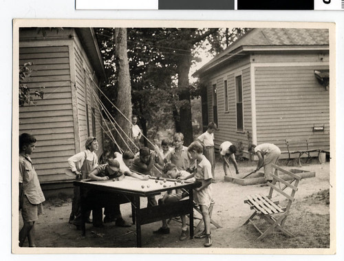 Boys playing billiards at Camp Sophie Worth