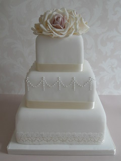 Lace wedding cake with sugar flowers by Cotton and Crumbs