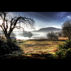 Morning mist (Tommimc) Tags: lake tree landscape grasmere lakedistrict earlymorning bluesky cumbria boathouse lakeland hdr morningmist