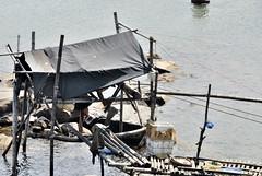 Vietnam. fishing cabin in Da Nang (pontfire) Tags: road trip travel bridge portrait holiday fish nature river boat asia vietnam pont pecheur poisson vacancy danang fishman