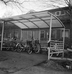 bike racks (rotabaga) Tags: sweden sverige svartvitt blackandwhite bw bwfp göteborg gothenburg johanneberg lomo lomography lubitel166 ilford r09 mediumformat mellanformat 6x6 120