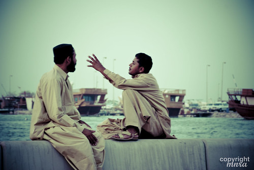 Two Friends Have a Conversations At Corniche Street
