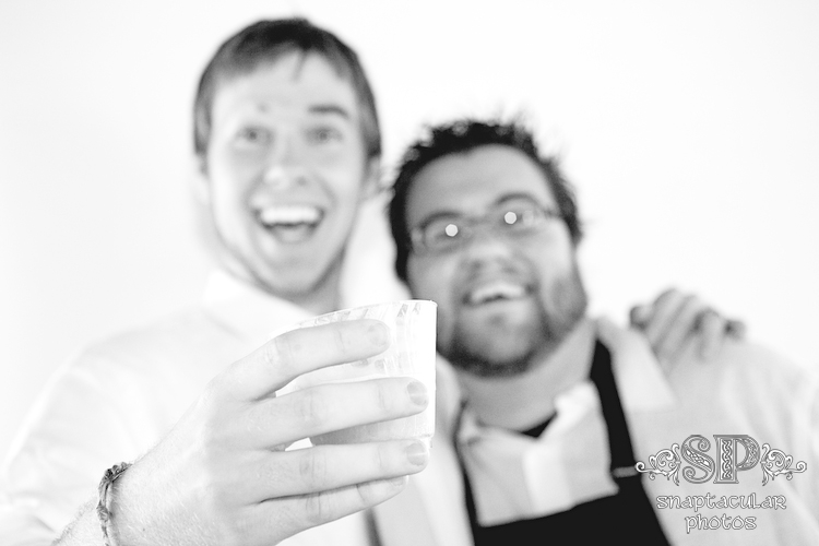 sam and his brother in law enjoying homemade frappuccino in the wedding reception photo booth at raven lodge huntsville state park huntsville tx