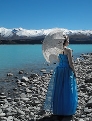 Pukaki Blue (Nic Temby) Tags: blue newzealand snow mountains t dress stones shore parasol mackenziecountry gown lakepukaki newzeland pukaki formaldress promdress bluedress ballgown southcanterbury balldress birthdayness