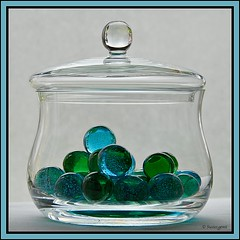 NOT YOUR AVERAGE CANDY JAR (susies.genii) Tags: stilllife macro glass marbles bluegreen candyjar