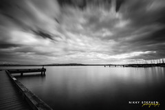 ExplosioN! (djniks) Tags: seattle sky lake water clouds dynamic explosion lakewashington hdr waterscape sigma1020 canon40d bw110ndfilter