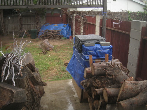 log soak tank in the rain