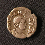 "<b>75 Reverse</b><br/> The Greek inscription reads ΑΛΞΑΝΔΡΕΑ (Alexandria), the location where it was probably minted. Here, Alexandria is personified by female warrior deity with a helmet fashioned from an elephant skull, modeled after how depictions such as Athena. To the Greeks and Romans, the elephant skull was representative of the entirety Africa.  Donated by Dr. Orlando ""Pip"" Qualley<a href=""http://farm3.static.flickr.com/2701/4351822680_79d9cf6b66_o.jpg"" title=""High res"">∝</a>"