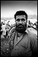 Bangladesh Man near Buriganga  River (earlb.com) Tags: poverty portrait bw india man water river nikon market poor oldman social sewage dhaka waste issues bangladesh arsenic ganges watertreatment olddhaka buriganga d700 bangladeshportrait imagesofolddhaka imagesofdhaka socialissuesinbangladesh