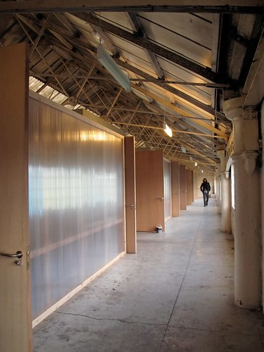 A man walks through Grand Union studios corridor