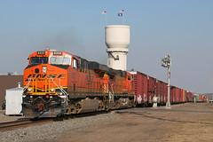 bnsf6333brainerd1 (mwahlsten) Tags: minnesota train watertower flags bnsf brainerd merchandisetrain brainerdsubdivision bnsfh3