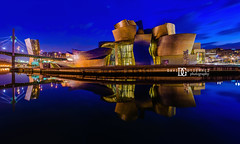 """Season Of Stillness"" Guggenheim Museum Bilbao (davidgutierrez.co.uk) Tags: photography davidgutierrezphotography city art architecture nikond810 nikon urban travel color night blue bilbao londonphotographer photographer guggenheim uk bluehour twilight dusk cloud basque bokeh puddle reflection street colors colours colour europe beautiful cityscape davidgutierrez structure d810 touristattraction attraction landmark icon culture water rain museum guggenheimbilbao reflections clouds frankgehry contemporary guggenheimmuseumbilbao arts architectural modern contemporaryart basquecountry longexposure le nerviónriver contemporaryarchitecture bilbaoeffect river"