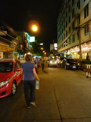 Lizzy walks down a Bangkok street