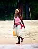 Girl of La Playa Blanca (Anastasiy Safari) Tags: sea people sun black beach girl yellow colombia gente african afro columbia latina afrocolombiana