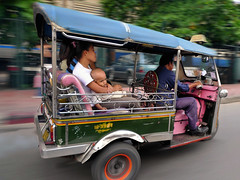 Tuk-tuk in Bangkok (Bn) Tags: topf50 bangkok taxi tuktuk topf100 bargain tms heavytraffic lotsoffun amazingthailand tellmeastory themovement krungthep supershot 100faves 50faves  symbolofthailand noveltyvalue motorizedrickshaws onthestreetsofbangkok soundoftheirengine forthreepeopleormore fasterthantaxis thaicitylife excitingcityexperience citylifepassingby popularamongsttourists since1960 amustdoexperience symbolofthaiingenuity symbolofbangkok essentialwayofgettingaroundinthailand thewindonyourface soundssmellsandsensations speedytuktuk