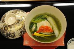 Red wakasa tilefish steamed with millet, baby daikon radish, yuzu peel, chrysantheneum sauce. Kikunoi, Kyoto