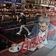 Criss cross (Gary Kinsman) Tags: boroughhighstreet borough london canon5d canon28mmf18 candid street photography reflection grilledfish sign window crossword puzzle crossing road concentrate concentration londonist se1 2009 people person