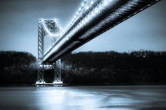 The George Washington Bridge (mudpig) Tags: nyc newyorkcity longexposure bridge blue bw white newyork black reflection night geotagged newjersey manhattan monotone hudsonriver georgewashington hdr gwb fortlee georgewashingtonbridge washingtonheights riverscape mudpig coldtone stevekelley