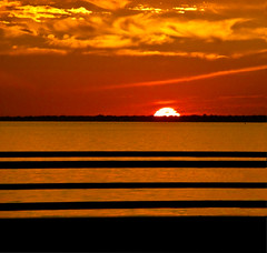 Sunset in Fire Island revisited (Sina Farhat) Tags: autumn sunset red sky orange sun black water yellow photoshop square warm horizon himmel rail before longisland rack pointandshoot after jpg 2008 vatten fireisland gul efter solnedgng svart rd cs4 pattens solen adobecameraraw mnster horisont varm revisit fre kompaktkamera olympussp550uz robertmosescausway terbesk fyrkanting