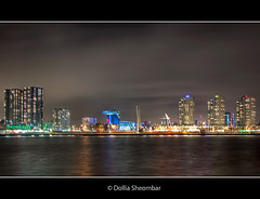 Rotterdam City Skyline (DolliaSH) Tags: city longexposure light people urban haven streets holland color water colors skyline architecture night reflections river photography lights noche photo rotterdam europe foto nightshot photos nacht harbour nederland thenetherlands wideangle illuminated explore le maas ultrawide nuit 1022mm notte stad 1022 noch zuidholland canonefs1022mmf3545usm efs1022mm rijnmond southholland explored nachtopname canoneos50d dollia dollias sheombar dolliash