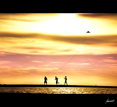 The Kite Runner {The Joy of Childhood} (Tomasito.!) Tags: sea portrait sky people sun kite seascape tourism beach boys childhood silhouette clouds painting children landscape fun happy nikon child play philippines memories happiness run spot tourist nostalgia touristspot d90 cagayandeoro albertoiglesias thekiterunner nikond90 artofimages bestcapturesaoi besttouristspots childrenbestphotos