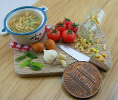 Fusili, tonight. (Shay Aaron) Tags: italy food house scale kitchen dinner tomato miniature leaf italian doll handmade board fake mini pasta pot polymerclay fimo tiny meal jar garlic faux basil onion spaghetti 12th 112 pesto preparation dollhouse petit ingredient clove twelfth boilingwater fusilli threecolored fusili twistedspaghetti
