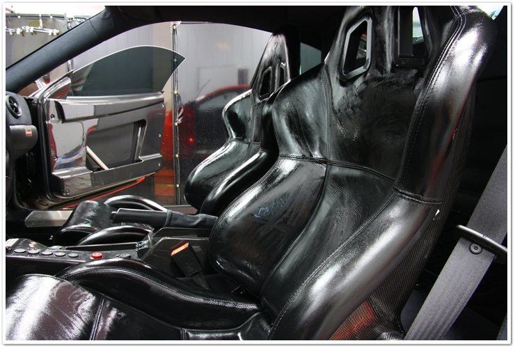 Ferrari Challenge Stradale leather seats soaking in Leatherique Rejuvinator Oil