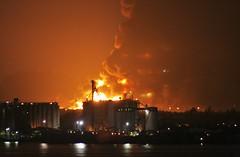 091023-5008-1 (jmoliver) Tags: night fire gulf puertorico object smoke refinery capeco explosionpr caribbeanpetroleum