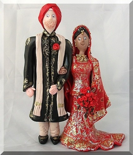 Bride and groom in traditionan indian wedding outfits