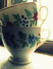 Waiting (Gigi Thibodeau) Tags: window naturallight cups teacups paintedflowers