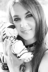 [a smile] (Gaietty) Tags: uk portrait england blackandwhite bw white black art girl smile face smiling lady female hair toy model eyes hands nikon cross teddy emotion artistic body tiger gothic goth makeup fluffy ring emotions gaze brace alternative choker 2012 gaietty