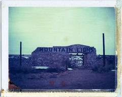 (moominsean) Tags: blue winter arizona abandoned polaroid zoo desert overcast instant remains chill 190 lonesome twoguns ndfilter mountainlions iduv expired022008