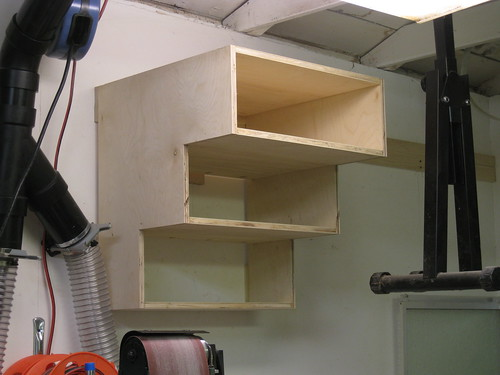shelving unit hung on wall