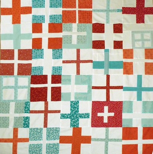 red and aqua cross quilt
