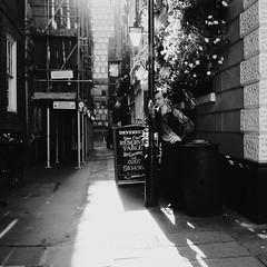 Man interrupted (Ian Brumpton) Tags: street blackandwhite bw london square blackwhite noiretblanc candid bodylanguage streetportrait londres biancoenero londonist urbantales londonstreetphotography lifeinslowmotion amomentofreflection