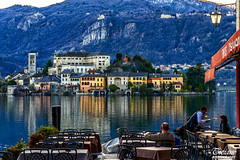 a beer by the lake, before the evening falls (Tizi@no56 (off)) Tags: houses people panorama lake mountains bar montagne reflections table landscape lago nikon view case persone vista riflessi tavoli d610 nikond610