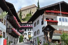 Scena (Schenna) - Typical flowered houses and the Castle (presbi) Tags: scena schenna sudtirol trentinoaltoadige cityscape castle castello ialy italia valpassiria