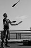 Money Juggling (Taylor.Buck) Tags: monochrome portrait street juggling preformer pier money hardtimes oceanside beach rentstoodamnhigh
