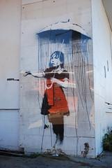 DSC_4208 (kccornell) Tags: new girl umbrella graffiti orleans louisiana banksy