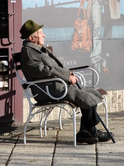 Elderly Man Soaks Up the Sun along the Danube - Pest Side - Budapest - Hungary