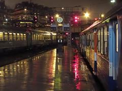 Saint Lazare #9 (philoufr) Tags: paris reflection rain station night train pluie quay reflet nuit quai sncf garesaintlazare canonpowershots90
